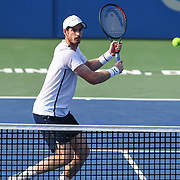 ANDY MURRAY hits a volley at the Rock Creek Tennis Center.