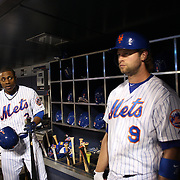 Curtis Granderson, (left) and Kirk Nieuwenhuis, New York Mets, preparing to bat in the dugout during the New York Mets Vs Atlanta Braves MLB regular season baseball game at Citi Field, Queens, New York. USA. 22nd September 2015. Photo Tim Clayton