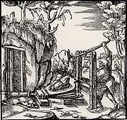 Ventilating a mine using bellows. From 'De re metallica', by Agricola, pseudonym of Georg Bauer (Basle, 1556).  Woodcut.  Mining.