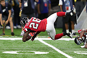 Atlanta Falcons running back Tevin Coleman (26) gets upended after catching a pass on a late second quarter play good for a gain of 6 yards during the 2016 NFL week 3 regular season football game against the New Orleans Saints on Monday, Sept. 26, 2016 in New Orleans. The Falcons won the game 45-32. (©Paul Anthony Spinelli)