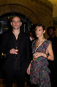 Dinos Chapman and Tiphaine de Lussis, Turner prize award  evening. Tate Gallery. 7 December 2003. © Copyright Photograph by Dafydd Jones 66 Stockwell Park Rd. London SW9 0DA Tel 020 7733 0108 www.dafjones.com