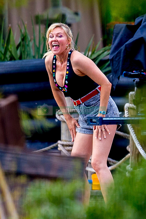 "EXCLUSIVE: Kirsten Dunst was spotted showing off her toned body while filming a pool scene for her AMC tv series ""On Becoming a God in Central Florida"". Kirsten wore a bejewelled black swimsuit with high rise denim shorts, accessorising with hooped gold earrings and her hair tied back in a ponytail. She could be seen filming scenes with fellow actor Kevin J. O'Connor while a group of swimmers all run out past the two. The series, filming in Louisiana, is about ""Krystal Gill"" (Dunst's character), a minimum-wage-earning water park employee who will eventually scheme her way up the ranks of Founders American Merchandise: the cultish, flag waving, multi-billion dollar pyramid scheme that drove her family to ruin. 19 Nov 2018 Pictured: Kirsten Dunst. Photo credit: MEGA TheMegaAgency.com +1 888 505 6342"