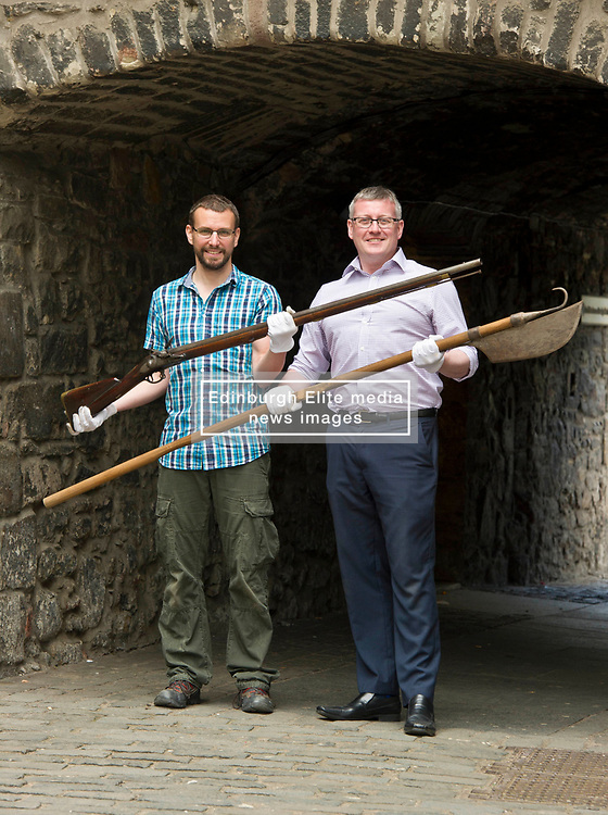 Pictured: Curator Nico Tyack (holding musket) and Museum Assistant David Mclay (holding a halberd)<br /> <br /> The latest Museum of Edinburgh exhibition documents the history of Edinburgh's Town Guard, which brought law and order to the city in the 18th century. Curator Nico Tyack and Museum Assistant David Mclay examined muskets, halberds and drums before the exhibition was opened to the public<br /> <br /> Ger Harley   EEm 15 June 2017