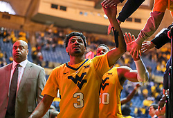 Dec 8, 2018; Morgantown, WV, USA; West Virginia Mountaineers guard James Bolden (3) celebrates with fans after beating the Pittsburgh Panthers at WVU Coliseum. Mandatory Credit: Ben Queen-USA TODAY Sports