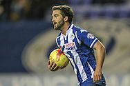 Will Grigg (Wigan) picks the ball up without celebrating his goal during the Sky Bet League 1 match between Wigan Athletic and Gillingham at the DW Stadium, Wigan, England on 7 January 2016. Photo by Mark P Doherty.