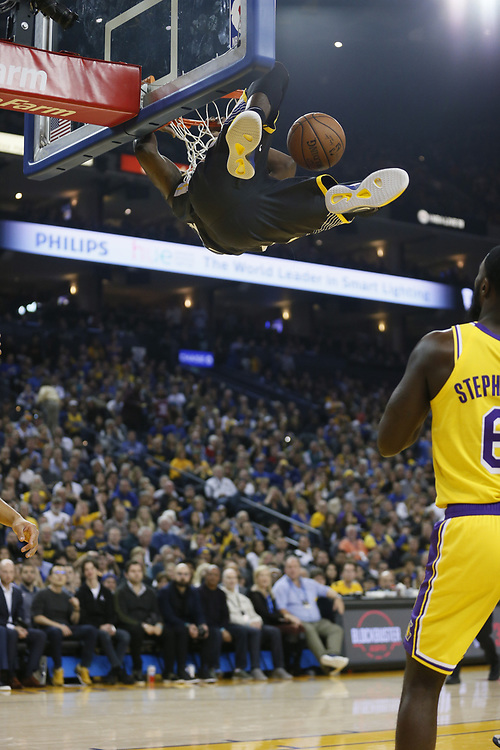 Golden State Warriors forward Draymond Green (23) dunks against the Los Angeles Lakers in the first half of an NBA game at Oracle Arena on Saturday, Feb. 2, 2019, in Oakland, Calif.