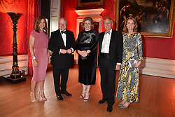Sara Watson, Chairman of the Tusk board Stephen Watson and his wife Emma Watson, Charlie Mayhew founder of Tusk and Caroline Mayhew at the Tusk Ball at Kensington Palace, London, England. 09 May 2019.
