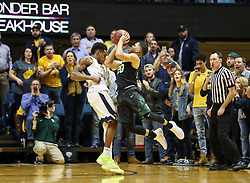 Jan 9, 2018; Morgantown, WV, USA; Baylor Bears guard Manu Lecomte (20) attempts to shoot a three pointer and draw contact during the second half against the West Virginia Mountaineers at WVU Coliseum. Mandatory Credit: Ben Queen-USA TODAY Sports