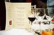 A lunch table at Chateau Giscours, Margaux, with a printed menu and wine glasses with red wine, Margaux Medoc Bordeaux Gironde Aquitaine France Europe