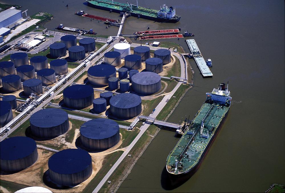 Oil tankers docked at tank farm in Port of Houston.