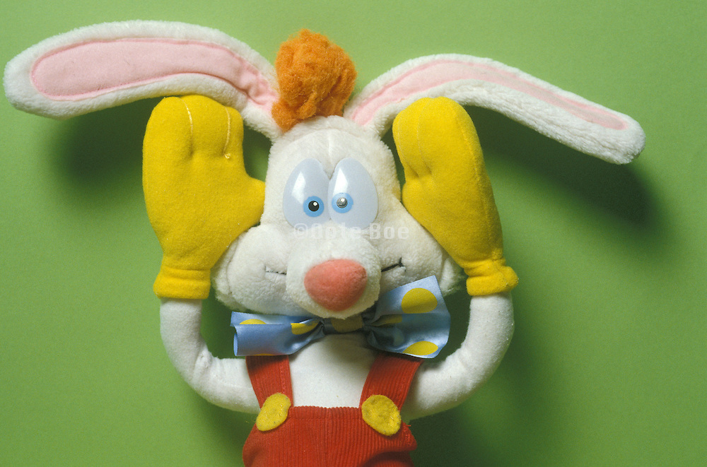 rabbit doll figure holding his hands to his ears