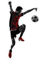 one asian soccer player young man dribbling in silhouette isolated white background