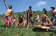 Space Goats playing at Twyford Down. Road Protest actions at Twyford Down, near the Donga pathways, outside Winchester, against the M3 road extension. 1992-94<br /><br />The British Road Protesters movement began in the early 1990s when the Donga tribe squatted Twyford Down to save this beautiful site, a site of scientific interest SSI from the Ministry of transport's road building programme which threatened to destroy the landscape. The Dongas was the name of the ancient walkways, the paths trodden in the middle ages by people walking down to Winchester. A small tribe were joined by people of all walks of life who came to Twyford Down to defend it. A long hard battle over several years ended in the 'cutting' a new motorway built through this ancient monument and destroying it. <br /><br />The Road Protest movement in Britain continued for many years and more battles were fought in London against the MII both at Wanstead then in Leytonstone, and subsequently at Newbury, and in Sussex. the protesters were very inventive in their use of non violent peaceful direct action. They barricaded themselves into squats, made tree houses, tunnels and have huge demonstrations against the bailliffs, police and security who tried to force their way through the defences of this alternative environmental popular movement. Many of the roads were built eventually and many sites of great beauty lost, but the government had to stand down from its road building policy and eventually the programme was halted. the protests cost the government billions. Out of that movement grew many environmental NGOs who have to this day kept fighting for ecological and sustainable environmental solutions rather than following the cult of the car, petrol and roadbuilding..