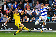 Burton Albion defender Jake Buxton (23) battles for the ball with Queens Park Rangers midfielder Luke Freeman (7) during the EFL Sky Bet Championship match between Queens Park Rangers and Burton Albion at the Loftus Road Stadium, London, England on 23 September 2017. Photo by Richard Holmes.
