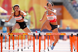England's Katarina Johnson-Thompson (right) with Canada's Nina Schultz during the 100m Hurdles element of the Women's Heptathlon, at the Carrara Stadium during day eight of the 2018 Commonwealth Games in the Gold Coast, Australia.