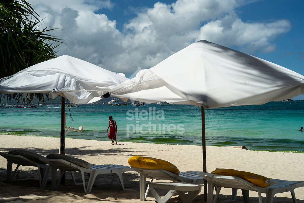 """The Philippines has announced a six-month closure of the popular tourist destination of Boracay over concerns the island's famous beaches and clear blue waters have been transformed into a """"cesspool"""" due to sustained environmental damage.<br /> The closure, which will begin on April 26th would be a """"total closure"""" to tourists.<br /> Picture shows tourists on the famous white sand beach.<br /> Picture by Daniel Hambury/@stellapicsltd 07813022858<br /> 25/04/2018"""