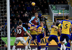 Burnley's Peter Crouch (centre) and Southampton's James Ward-Prowse (bottom centre) contest a header