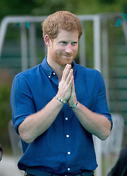 Prince Harry watches a martial arts display at the Jamiyah Education Centre in Singapore.
