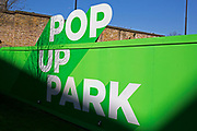 Sign for a pop up park at new development London Dock in Wapping in London, England, United Kingdom.