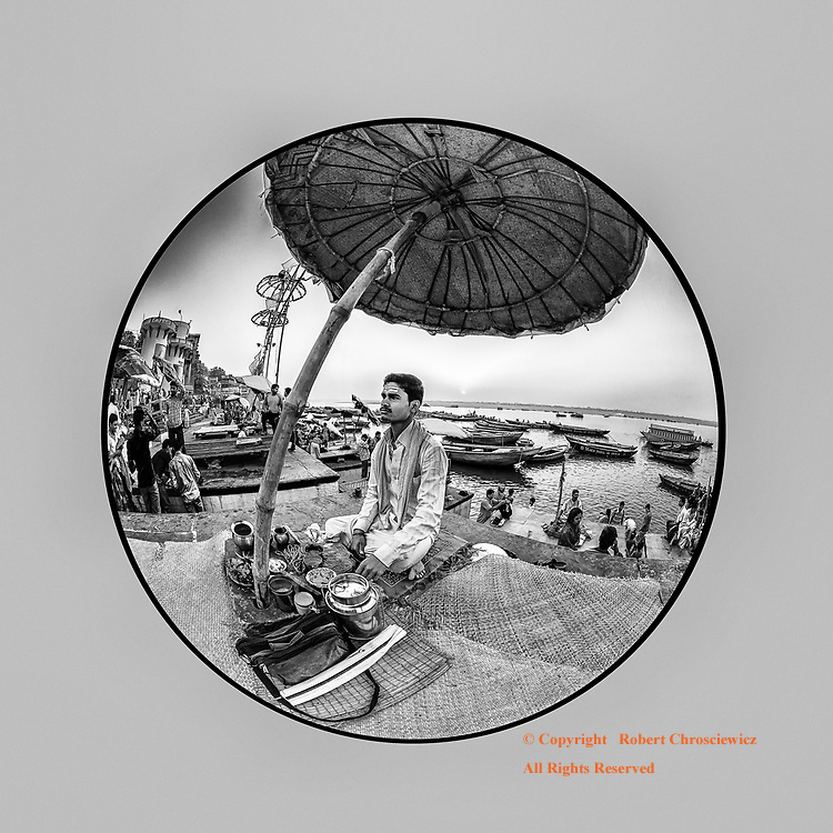 Devotees Circular Life (B&W): This circular fisheye view captures in this early morning scene on the Ganges River and accentuates the theme of the circular nature of life; as a Hindu devote readies for yet another day, preaching his truth with his incense, powders and offerings at hand, Varanasi India.