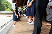Japanese junior high school students at the Ryoanji temple zen stone garden in Kyoto