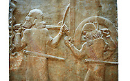 Stone relief sculptured panel of soldiers carrying a war chariot . Facade L. Inv AO 19884 from Dur Sharrukin the palace of Assyrian king Sargon II at Khorsabad, 713-706 BC.  Louvre Museum Room 4 , Paris .<br /> <br /> If you prefer to buy from our ALAMY PHOTO LIBRARY  Collection visit : https://www.alamy.com/portfolio/paul-williams-funkystock/ancient-assyria-antiquities.html  Refine search by adding background colour, place, subject, museum etc into the LOWER SEARCH WITHIN GALLERY box to <br /> <br /> Visit our ANCIENT ASSYRIAN PHOTO COLLECTIONS for more photos to download or buy as wall art prints https://funkystock.photoshelter.com/gallery-collection/Ancient-Assyrian-Art-Artefacts-Antiquities-Historic-Sites-Pictures-Images-of/C0000cjRqQyJjLag