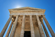 Facade of the Maison Carrée, a ancient Roman temple built around 4-7 AD and dedicated to Julius Caesar, the best preserved example of a Roman temple,  Nimes, France . In about 4-7 AD, the Maison Carrée was dedicated or rededicated to Gaius Caesar and Lucius Caesar, grandsons and adopted heirs of Augustus who both died young. The Maison Carrée is a classic example of Vitruvian architecture as it is nearly an exact replica of a Tuscan style Roman temple described in the writings of the famous architect Vitruvius. Raised on a 2.85 m high podium, and at 26.42 m by 13.54 m forming a rectangle almost twice as long as it is wide, the temple dominated the forum of the Roman city of Nîmes. .<br /> <br /> Visit our ROMAN ART & HISTORIC SITES PHOTO COLLECTIONS for more photos to download or buy as wall art prints https://funkystock.photoshelter.com/gallery-collection/The-Romans-Art-Artefacts-Antiquities-Historic-Sites-Pictures-Images/C0000r2uLJJo9_s0