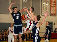 Belmont's Doug Price gets pressure from Shawn Dekorne and Zac Carberry during NHIAA Division III second round tournament action at Belmont High School Thursday evening.  (Karen Bobotas/for the Laconia Daily Sun)