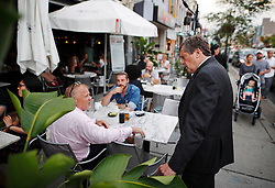Toronto Mayor John Tory speaks with restaurant patrons after attending a vigil remembering the victims of a shooting on Sunday evening on Danforth, Ave. in Toronto, ON, Canada, on Monday, July 23, 2018. Photo by Mark Blinch/CP/ABACAPRESS.COM