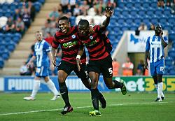 Peterborough United's Gabriel Zakuani celebrates scoring his goal with team-mate Britt Assombalonga  - Photo mandatory by-line: Joe Dent/JMP - Tel: Mobile: 07966 386802 06/08/2013 - SPORT - FOOTBALL - Weston Homes Community Stadium - Colchester -  Colchester United V Peterborough United - Capital One Cup - First Round