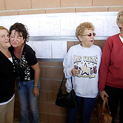 LAS VEGAS, NEVADA, November 12, 2007: Contestants from around the world gathered in Las Vegas, Nevada on November 12, 2007 to race their pigeons in the Las Vegas Classic. Wives gather with Debbie Sittner, second from left, who had entered pigeons in the race.