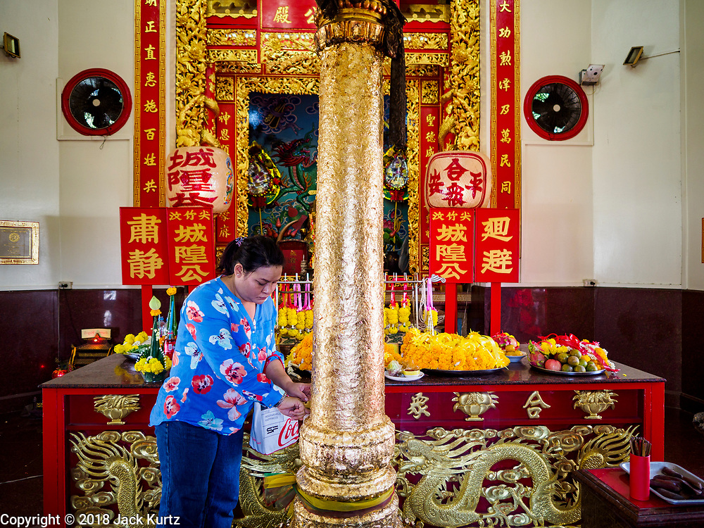 24 DECEMBER 2018 - CHANTABURI, THAILAND:  People pray in the city pillar shrine in Chantaburi. Most Thai cities have a city pillar shrine, which serves both to house the city spirit deity and symbolise the central power of Bangkok. Chantaburi is the capital city of Chantaburi province on the Chantaburi River. Because of its relatively well preserved traditional architecture and internationally famous gem market, Chantaburi is a popular weekend destination for Thai tourists.   PHOTO BY JACK KURTZ