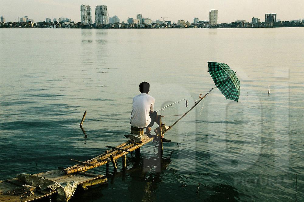 Fisherman on Tay Ho (west lake). Hanoi