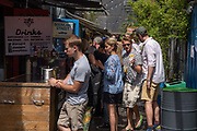 Large queues at the food stalls at Pop Brixton on the 24th July 2019 in South London in the United Kingdom. Pop Brixton is a community project and event venue as well as location for many local independent retailers, restaurants, street food startups and social enterprises.