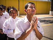 02 FEBRUARY 2013 - PHNOM PENH, CAMBODIA:   A man waits in line to see the crematorium of King Norodom Sihanouk during the mourning period for Sihanouk, who ruled Cambodia from independence in 1953 until he was overthrown by a military coup in 1970. Sihanouk died in Beijing, China, in October 2012.      PHOTO BY JACK KURTZ