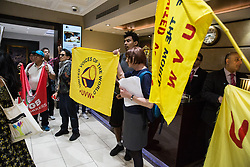 London, UK. 1 June, 2019. Members of the United Voices of the World (UVW) and Independent Workers of Great Britain (IWGB) grassroots trade unions protest inside the DoubleTree Hilton Hotel in solidarity with Dalia Quinonez Guerrero a former cleaner from whom wages were withheld. The protest was previously arranged to have taken place outside Chanel but arrangements were changed after the global fashion chain agreed to pay its cleaners the London Living Wage at its stores.