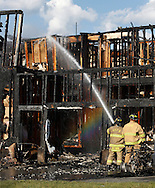 Vails Gate firefighters work at the scene of a fire that destroyed a house on Independence  Drive on Friday, Aug. 16, 2013.