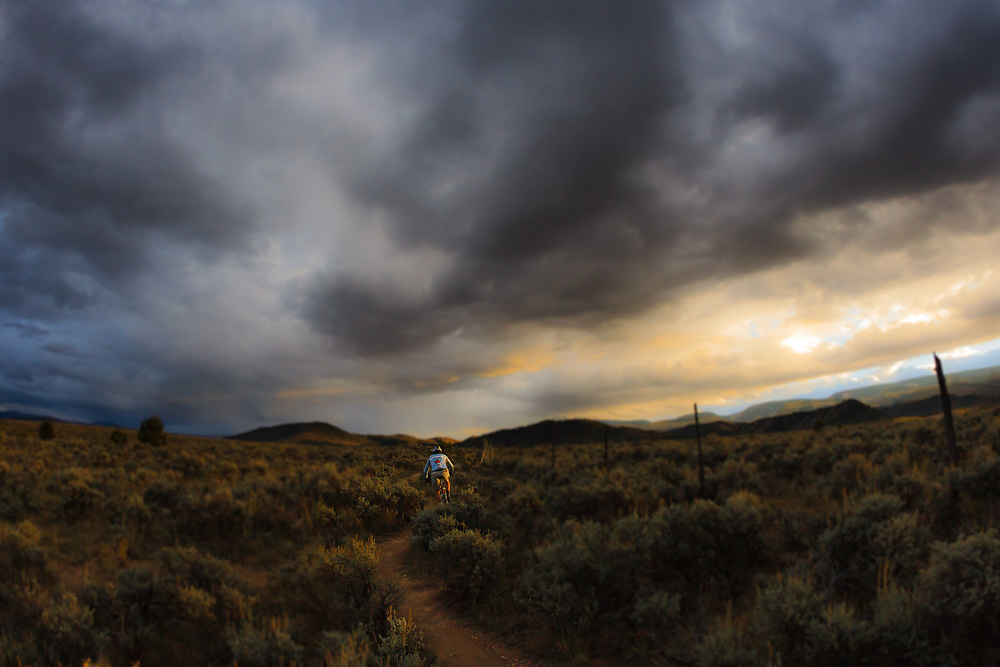 Ted Gould rides Wild Roses at sunset as the storm clouds part for mere minutes in Eagle Ranch, Colorado.