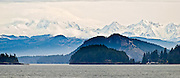 From the San Juan Islands ferry in Rosario Strait (in the Salish Sea), see the volcanic cone of Mount Baker rising to 10,775 feet elevation near Twin Sisters Mountain in Mount Baker Wilderness. Washington State Ferries, USA. Panorama stitched from 2 images.