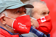 """A supporter with a face mask reading """"Team Olaf SPD"""" during an election campaign event of the German Social Democratic Party (SPD) at Bebelplatz square In Berlin, Germany, August 27, 2021. Germany's federal elections are due to take place on September 26, 2021."""