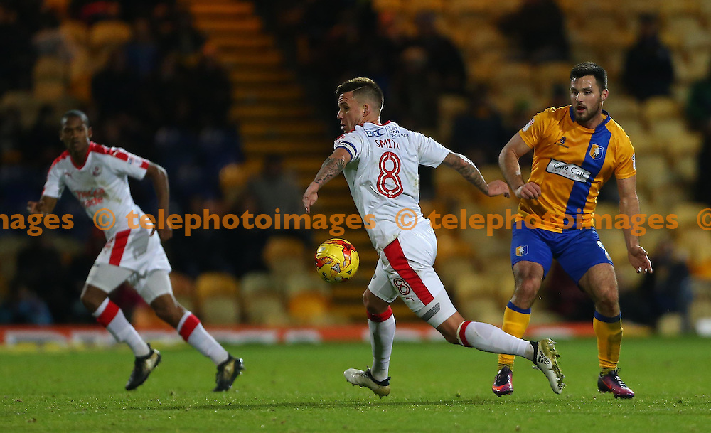 Crawley's Captain Jimmy Smith  runs onto the ball during the Sky Bet League 2 match between Mansfield Town and Crawley Town at the One Call Stadium in Mansfield. November 19, 2016.<br /> James Boardman / Telephoto Images<br /> +44 7967 642437