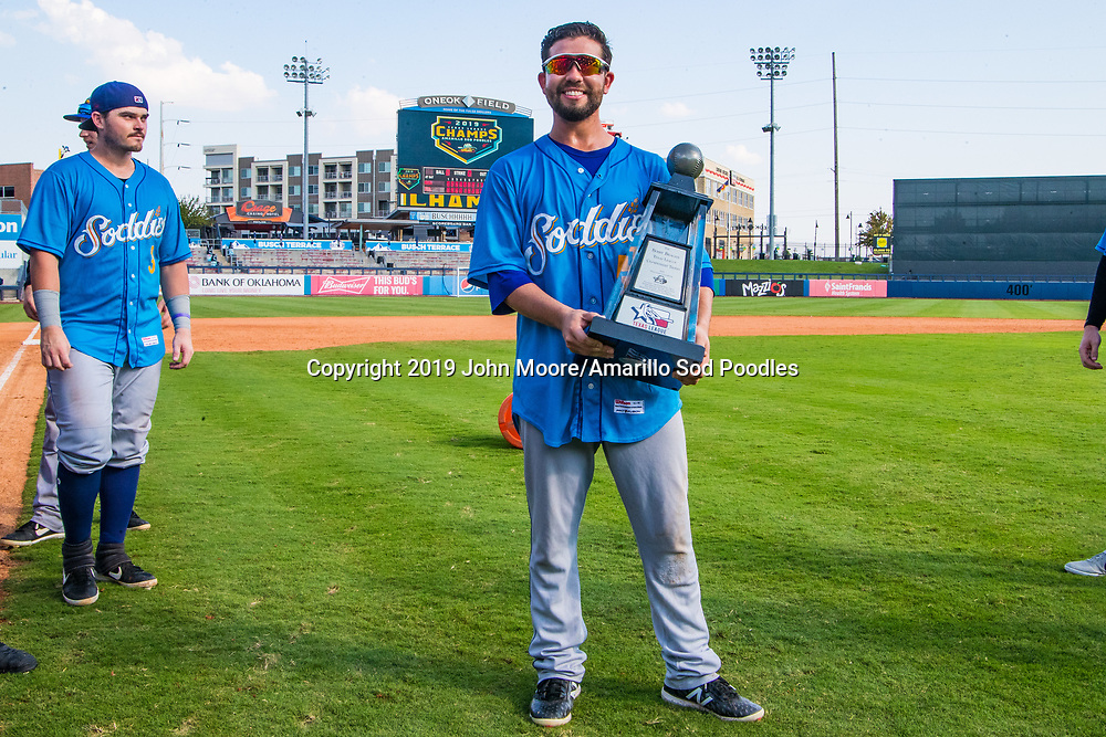 Amarillo Sod Poodles infielder Peter Van Gansen (5) poses with the trophy after the Sod Poodles won against the Tulsa Drillers during the Texas League Championship on Sunday, Sept. 15, 2019, at OneOK Field in Tulsa, Oklahoma. [Photo by John Moore/Amarillo Sod Poodles]