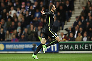 Brighton & Hove Albion centre forward Glenn Murray (17) scores a goal 1-0 and celebrates during the EFL Sky Bet Championship match between Queens Park Rangers and Brighton and Hove Albion at the Loftus Road Stadium, London, England on 7 April 2017.