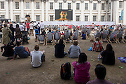 Spectators watch live TV coverage of the Diving event with young Team GB athlete Tom Daley at the old Royal Naval College, Greenwich on day 4 of the London 2012 Olympic Games. Greenwich Park is hosting the Olympic Equestrian competitions, plus the combined running and shooting event of the Modern Pentathlon. The Old Royal Naval College is the architectural centrepiece of Maritime Greenwich, a World Heritage Site in Greenwich, London. The buildings were originally constructed to serve as the Royal Hospital for Seamen at Greenwich, now generally known as Greenwich Hospital, which was designed by Christopher Wren, and built between 1696 and 1712.