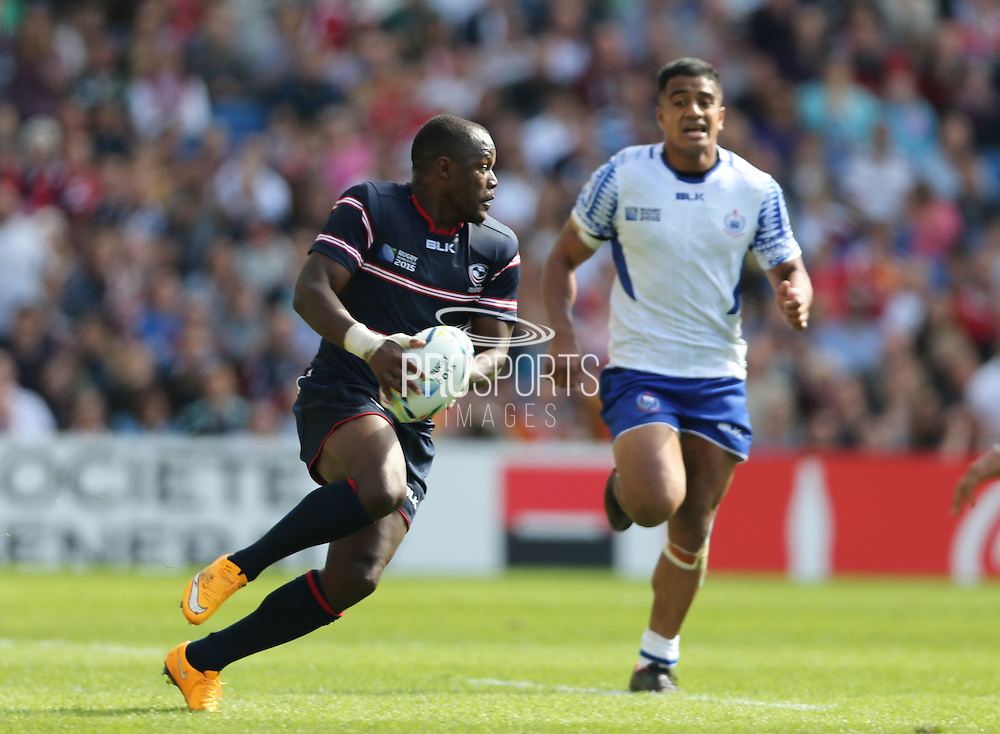 USA Takudzwa Ngwenya running with the ball during the Rugby World Cup 2015 match between Samoa and USA at the Brighton Community Stadium, Falmer, United Kingdom on 20 September 2015.