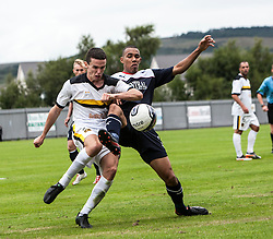 Dumbarton's Paul McGinn and Falkirk's Phil Roberts.<br /> Dumbarton 1 v 1 Falkirk, Scottish Championship 10/8/2013.<br /> ©Michael Schofield.