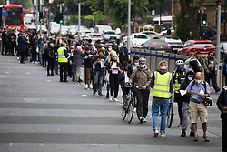 © Licensed to London News Pictures.  20/06/2021. London, UK. Members of the public queue at Tottenham Hotspur Stadium, north London where Covid-19 vaccines are being offered to all adults over the age of 18. Photo credit: Marcin Nowak/LNP