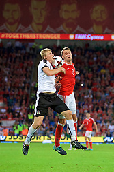 CARDIFF, WALES - Saturday, September 2, 2017: Wales' Andy King and Austria's Martin Hinteregger during the 2018 FIFA World Cup Qualifying Group D match between Wales and Austria at the Cardiff City Stadium. (Pic by Paul Greenwood/Propaganda)