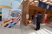 Visitors play traditional games and pose with carp flag pictures during Haneda International Airport, Tokyo, Japan. Tuesday May 3rd 2016. The Edo festival takes place over the three days of national holidays called Golden Week ( May 3rd to 5th) and features costume parades, music and stage shows along with other fun activities for visitors in and around the Edo themed shopping areas in the terminal building.