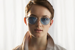 Young Woman Wearing Blue Tinted Sunglasses